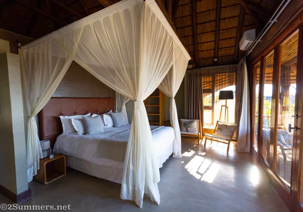 Bedroom in the deluxe suite at Mhondoro Safari Lodge