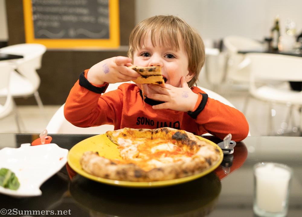Giuliano eating pizza at Bistro Dolce Vita restaurant in Morningside