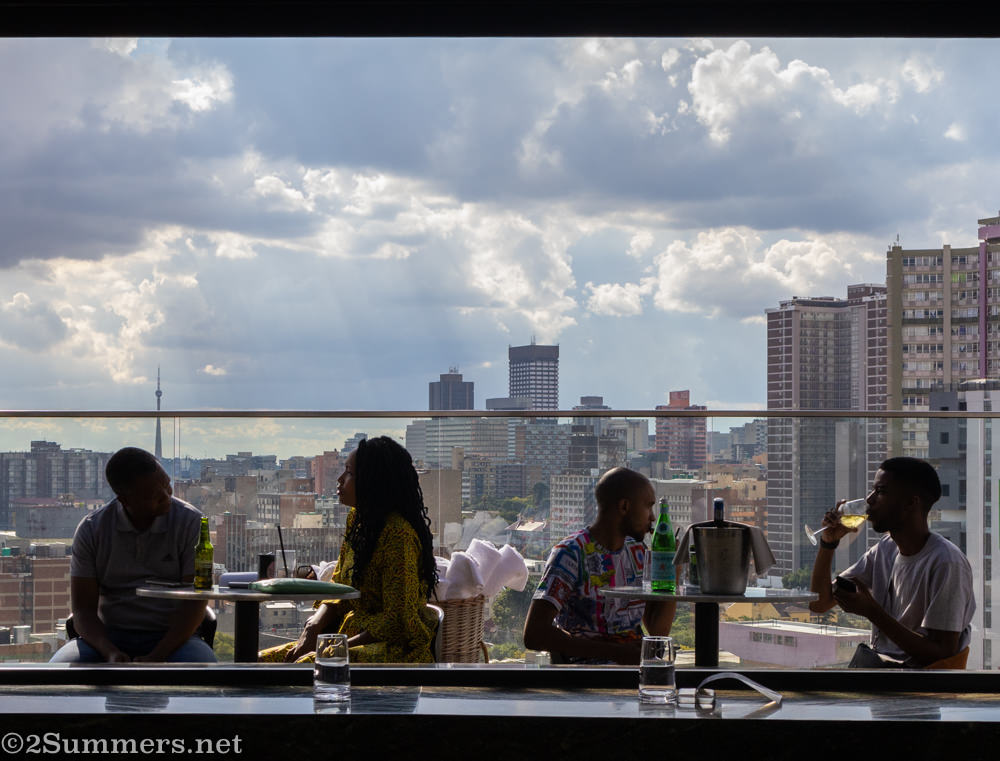 People drinking cocktails in the Joburg CBD.