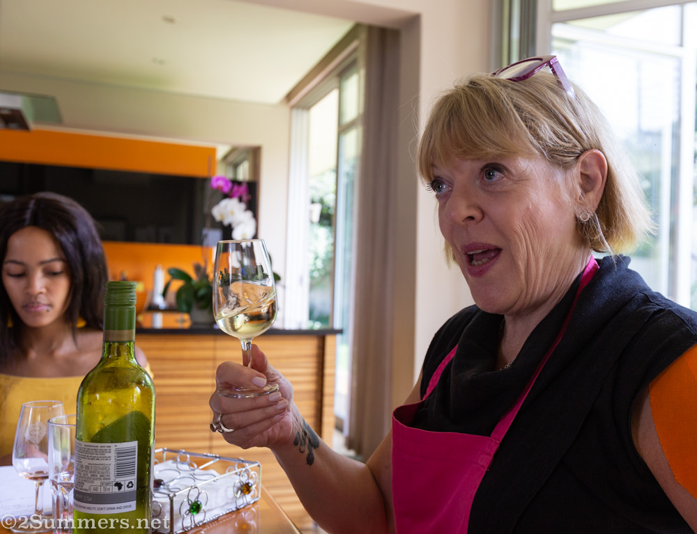 Janice shaking up a glass of wine.