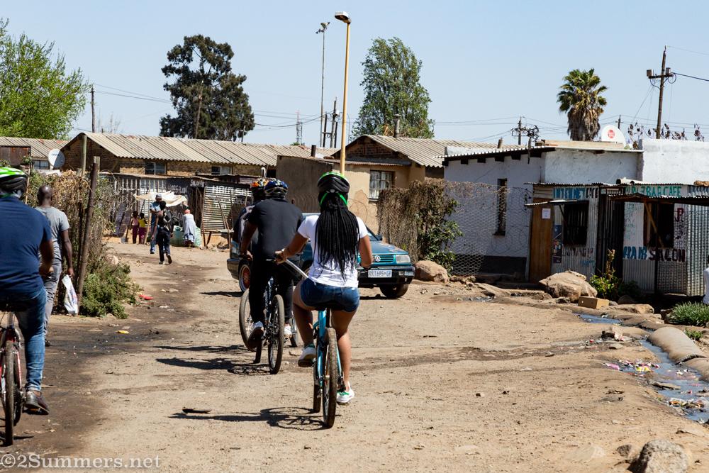 Riding through Mzimhlophe men's hostel
