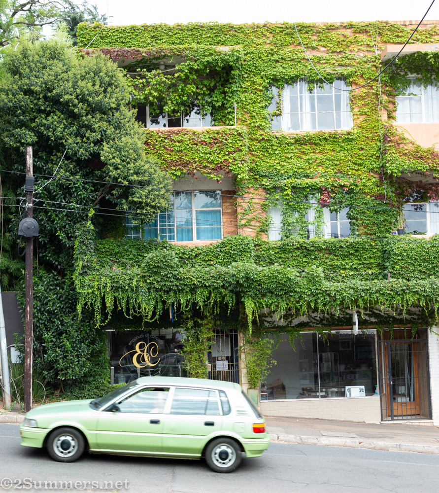 Green building and green car in Melville