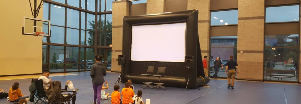 Movie night for neighborhood kids inside their local police station.