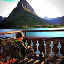 LittleMan on balcony at Many Glacier Hotel Swiftcurrent Lake