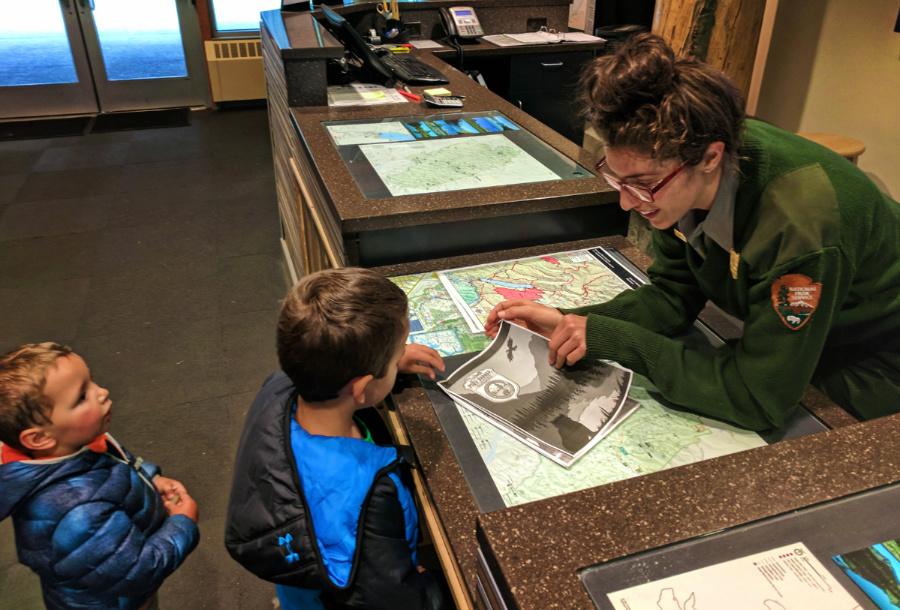 Taylor Family completing Junior Ranger program Apgar Visitors Center in Glacier National Park 1
