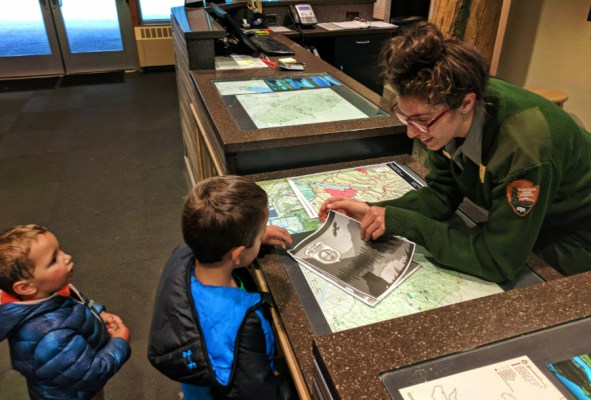 Taylor Family completing Junior Ranger program Apgar Visitors Center in Glacier National Park 1