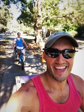 Rob Taylor with kid trailer while Biking St Simons Island GA 1