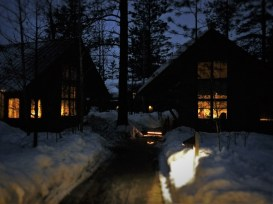Cabins in the Snow at Night at Sleeping Lady Resort Leavenworth WA 1