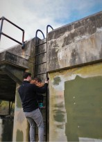 Chris Taylor and LittleMan Climbing Bunkers at Fort Worden