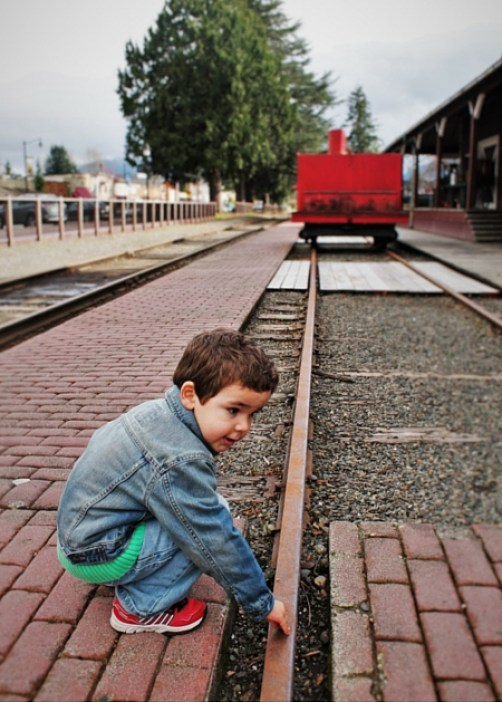 LittleMan Testing Railroad Track at Old Snoqualmie Train Depot Washington 2traveldads.com
