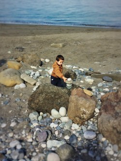 LittleMan stacking rocks on beach at Point Wilson Lighthouse Fort Worden Port Townsend 1