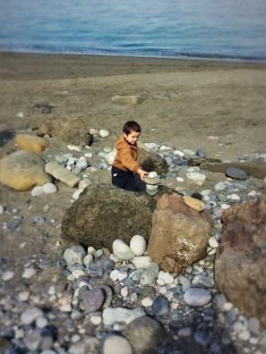 LittleMan stacking rocks on beach at Point Wilson Lighthouse Fort Worden Port Townsend 1