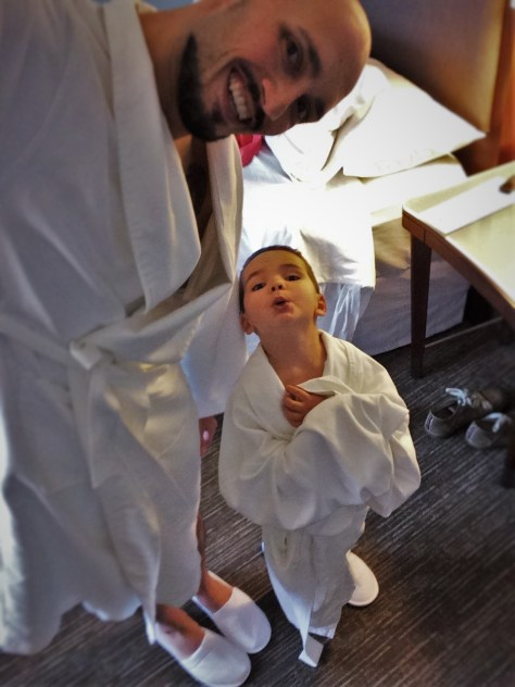 Rob Taylor and LittleMan in bathrobes Luxury Suite at Westin Seattle 1