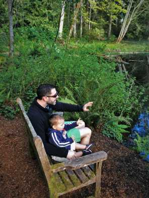 Chris Taylor and TinyMan by still pond at Bloedel Reserve Bainbridge Island 3