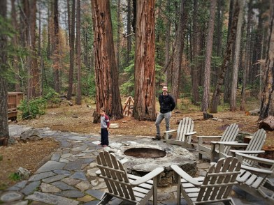 Chris Taylor and LittleMan by fire pit at Evergreen Lodge at Yosemite 2traveldads.com