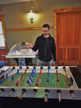 Chris Taylor playing foosball at Evergreen Lodge at Yosemite National Park 1