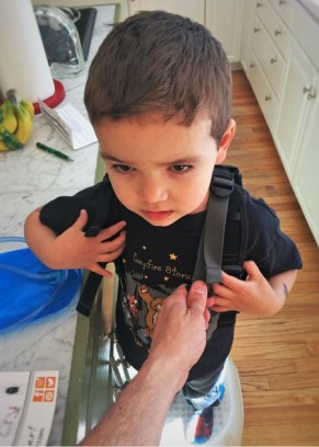 LittleMan trying on Piggyback Rider 2traveldads.com
