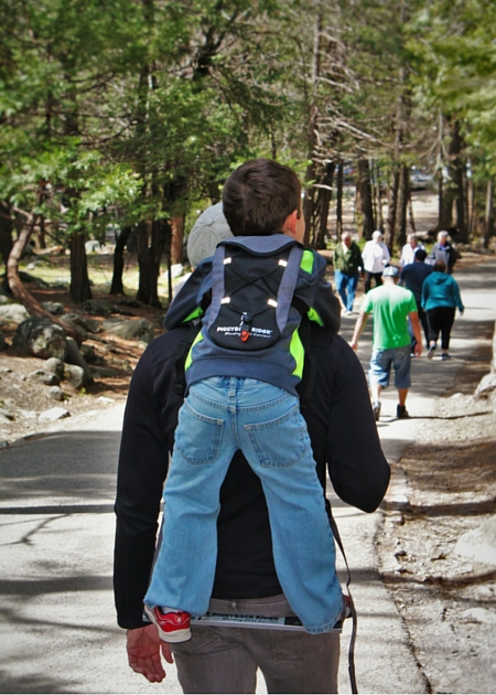 LittleMan using Piggyback Rider at Bridal Veil Falls Yosemite National Park 2traveldads.com