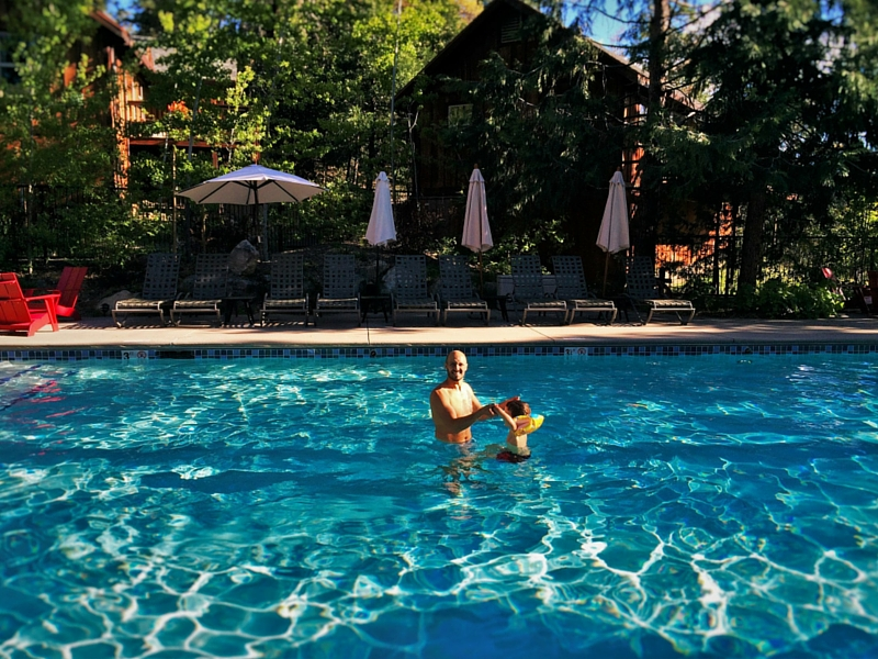 Rob Taylor and LittleMan in Pool at Evergreen Lodge at Yosemite 2traveldads.com