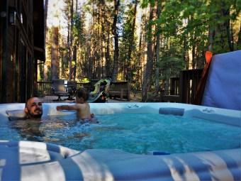 Rob Taylor and TinyMan in hot tub at John Muir House at Evergreen Lodge at Yosemite National Park 1