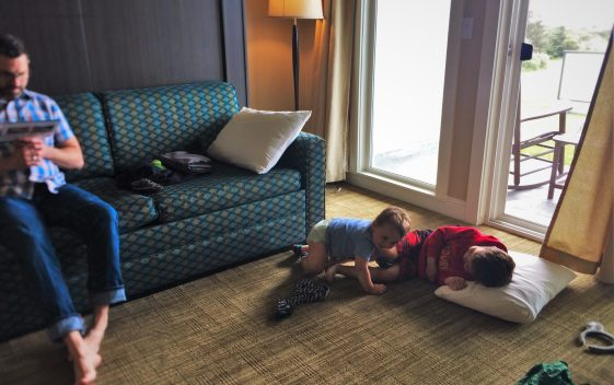 Kids in living room at Condo unit at Pacific Reef Hotel Gold Beach Oregon Coast