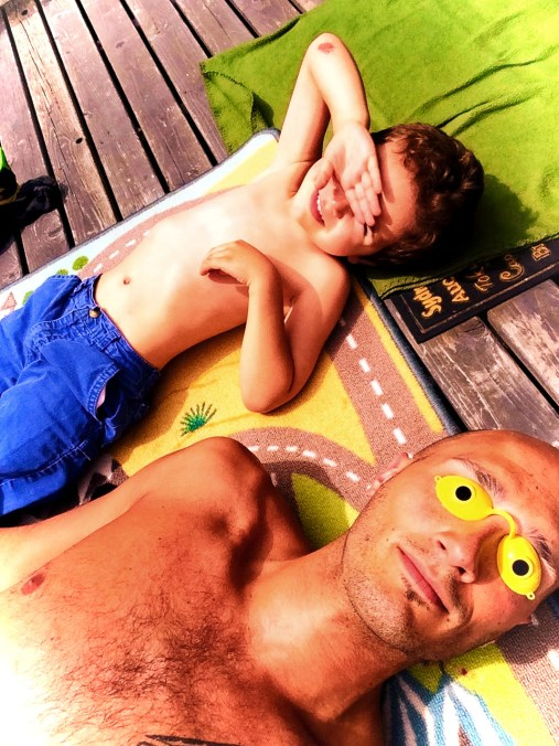 Rob Taylor and LittleMan lying in sun