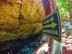 Evacuation sign at Mouth of Cenotes Dos Ojos Playa del Carmen Mexico