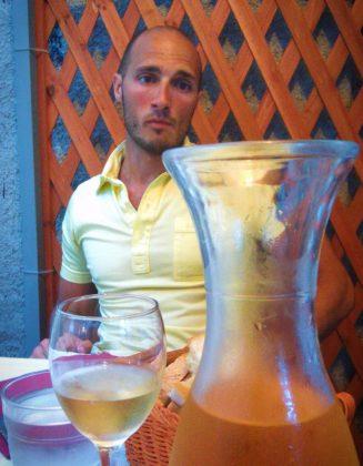 Rob Taylor and Wine Karaffe in Monterosso Cinque Terre Italy 1e