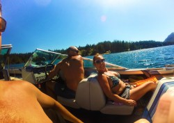 Rob Taylor driving speed boat with family at Lake Cushman Olympic Peninsula