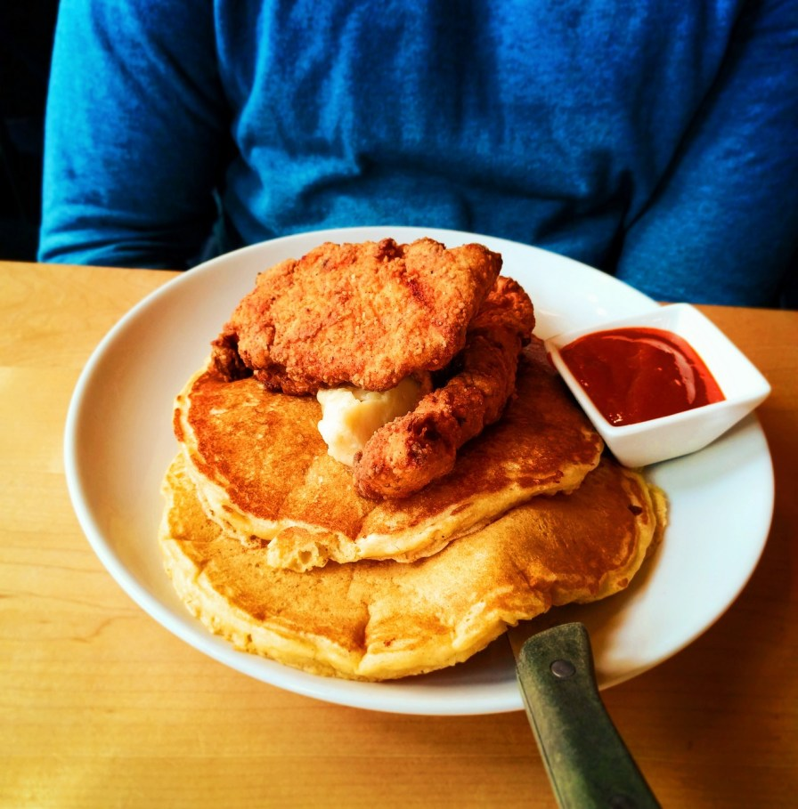 Cornmeal pancakes and fried chicken at Bijou Cafe Portland restaurant 1