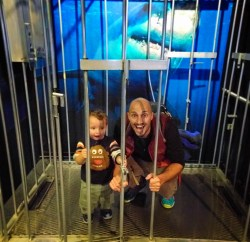 Rob Taylor and son in Shark Cage Tennessee Aquarium 1