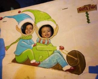 Taylor Kids in Christmas Elf Cutout Lights of Life Marietta Georgia 1