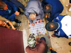 Old Men playing Chinese game in street Baoji China 2