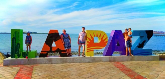 Taylor Family at La Paz VisitMexico sign 1