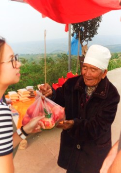 Old lady selling fruit at rural road Yanan Shaanxi 1