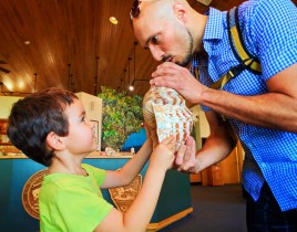 Taylor Family playing conch shell in Biscayne National Park Visitors Center 1