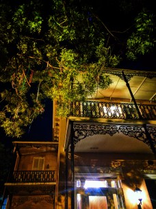 Mardi Gras beads and Wrought iron balcony in Mobile Alabama historic distric 1