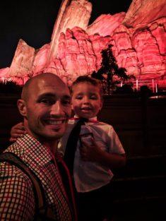 Taylor family waiting at Radiator Springs Racers Cars Land at Night Disneys California Adventure 1