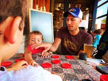 Taylor Family playing checkers at Grumpy Troll Brewpub Mt Horeb Wisconsin 4