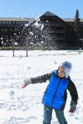 Taylor Family playing in snow at Glacier Park Lodge East Glacier