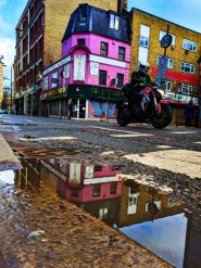 Reflection with motorcycle Sidestreet Shorditch London UK 1