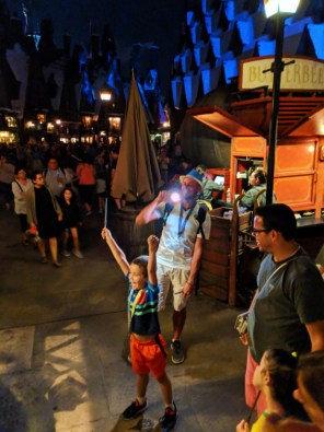 Taylor Family Casting Spells in Hogsmeade Wizarding World of Harry Potter Universal Islands of Adventure 3