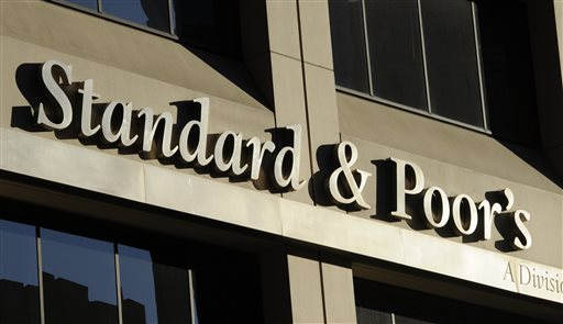 Standard & Poor's is paying about $1.38 billion to settle government allegations that it knowingly inflated its ratings of risky mortgage investments that helped trigger the financial crisis. | AP file photo