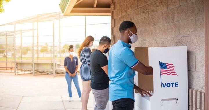 Waiting in line and voting. (Credit: iStockPhoto)