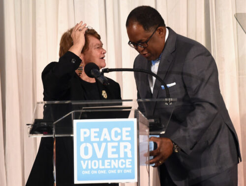 LA County Board of Supervisors Sheila Kuehl and LA County Board of Supervisors Mark Ridley-Thomas speak onstage at The 44th Annual Peace Over Violence Humanitarian Awards at Dorothy Chandler Pavilion on October 16, 2015 in Los Angeles, California. (Oct. 15, 2015 - Source: Jason Merritt/Getty Images North America)