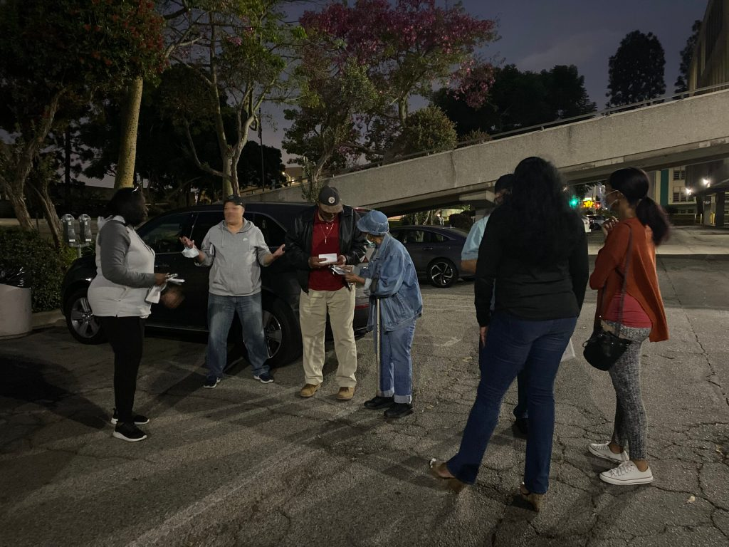 Inglewood residents gather outside of the Main Library after city abruptly cancels October 6 Planning Commission Meeting. (Credit: 2UrbanGirls)