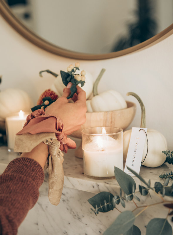 Sydne Style shows easy fall home decor ideas with candles on fireplace