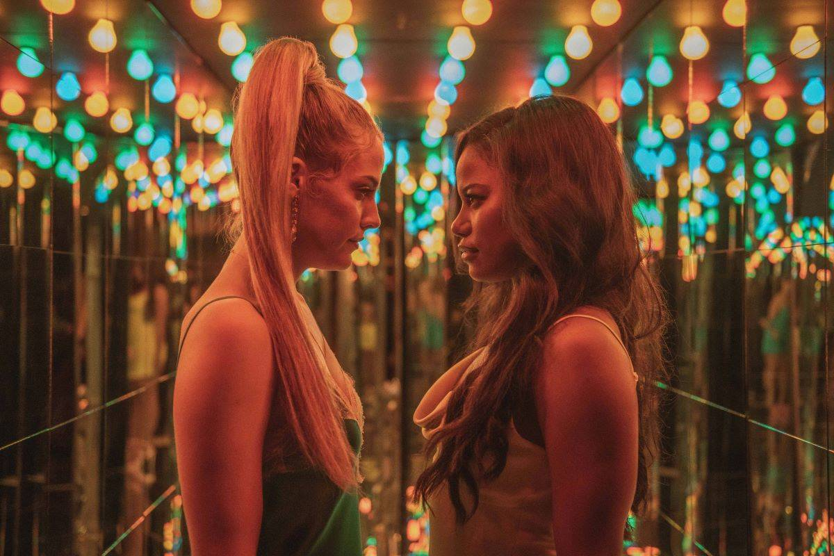 Riley Keough, left, and Taylour Paige star in ??  Zola, ??  a film about women interested in pole dancing which is based on a Twitter thread.  (Courtesy of A24)
