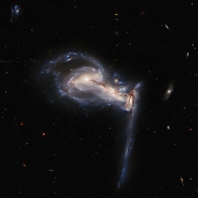 Hubble captures stunning gravitational interaction among a trio of galaxies