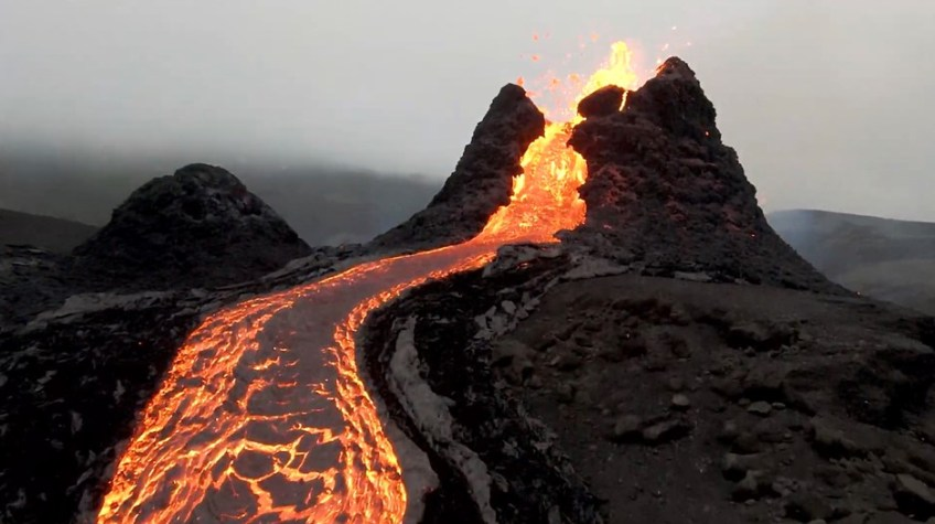 Video: Incredible footage of a drone flying over an erupting volcano in Iceland